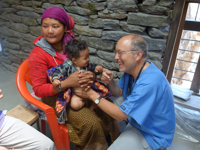 Dr. Sagin delivering medical care on a service trip in Nepal.